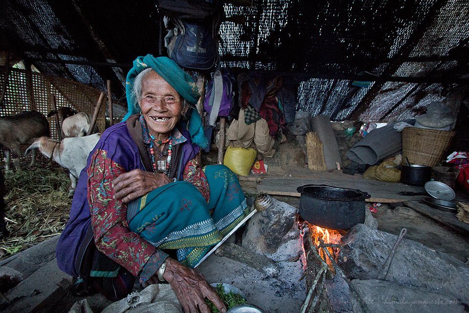 Nepal earthquake relief victim smiling in new shelter.