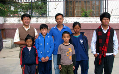 children and teachers at school in Nepal