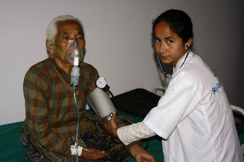 doctor at Nepal Medical camp with patient