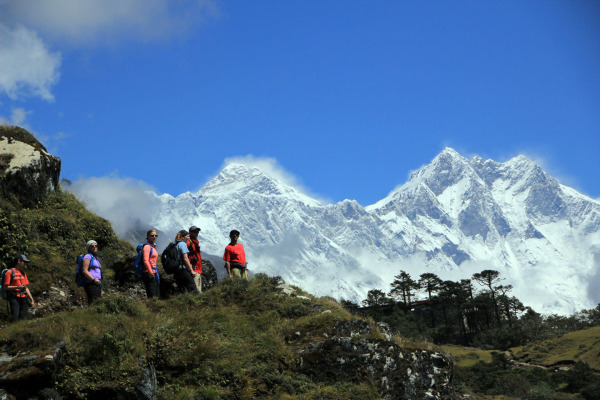 trekkers under the Himalayas in Nepal